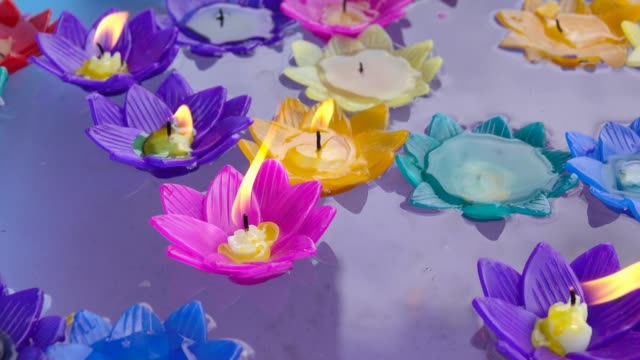 floating colorful candles - christmas decore candle stock videos & royalty-free footage
