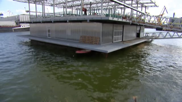 floating dairy farm in rotterdam, cows milked where consumers live reducing the need for transportation and carbon emissions - floating on water stock videos & royalty-free footage