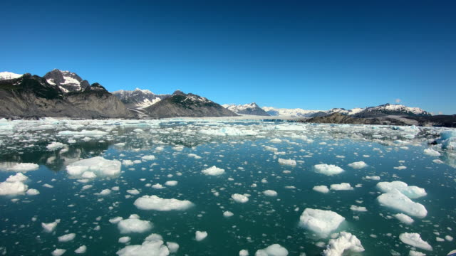 pov floating glacial ice broken from glacier alaska - pacific war stock-videos und b-roll-filmmaterial