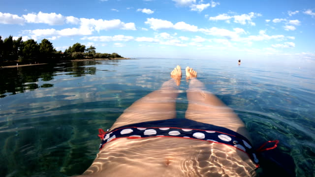 floating in the sea - under her feet stock videos & royalty-free footage