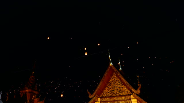 Floating Lantern Over Ancient Temple in Yi Peng Festival, Chiang Mai Province, Thailand