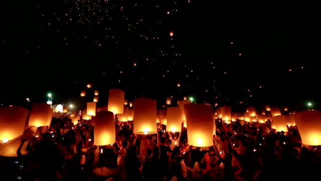 floating lantern with crowd - paper lantern stock videos and b-roll footage