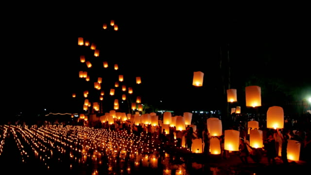 floating lantern , yi peng festival , chiangmai thailand - hot air balloon stock videos & royalty-free footage