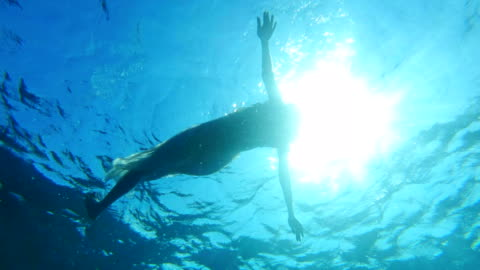 floating on water. sea relaxation - floating on water stock videos & royalty-free footage