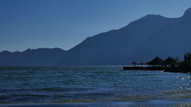 Floating restaurant at Batur lake with sunrise Bali ,Indonesia.