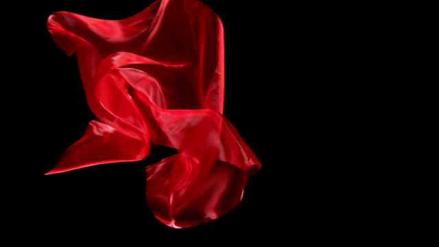 slow-mo: floating silk on black background - levitation stock videos & royalty-free footage