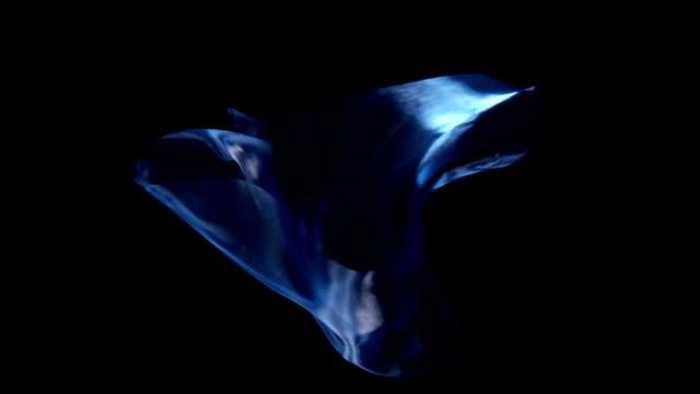 SLOW-MO: Floating silk on black background