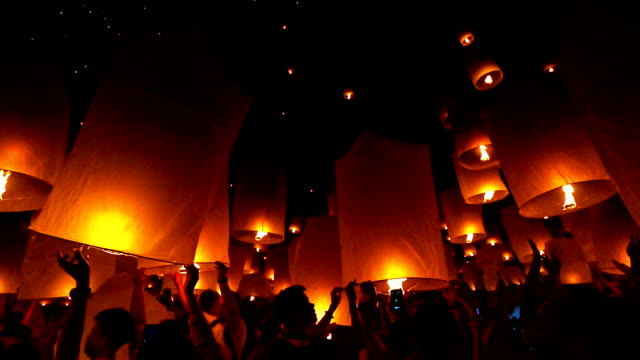 floating sky lantern, loi krathong festival in thailand - sky lantern stock videos & royalty-free footage