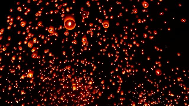 floating sky lantern - sky lantern stock videos and b-roll footage