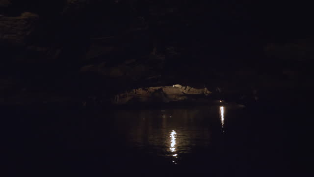 floating through a cave in a boat - cave stock videos & royalty-free footage