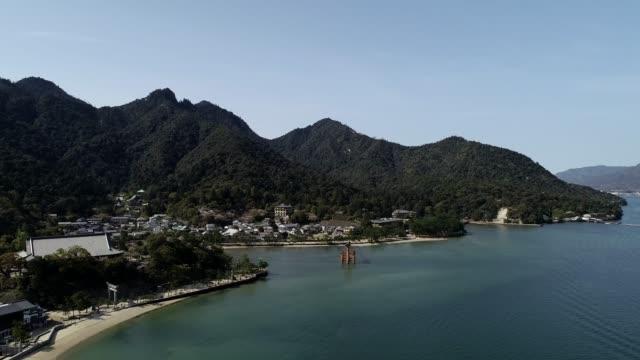 floating torii gate and itsukushima shrine complex, unesco world heritage site, miyajima island, hiroshima prefecture, japan, asia - shinto shrine stock videos & royalty-free footage