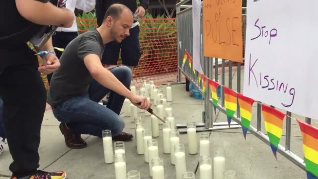 floats from 2016 la pride parade lgbt members commemorate victims of orlando shooting as they prepare for the 2016 la pride parade soundbite includes... - west hollywood bildbanksvideor och videomaterial från bakom kulisserna