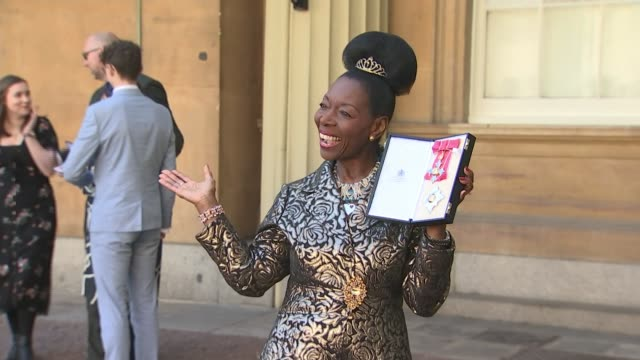 floella benjamin receives damehood for services to charity england london buckingham palace ext close shot dame floella benjamin posing with medals... - floella benjamin stock videos & royalty-free footage
