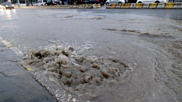 flood after the rain is flowing down the drain on the road - torrential rain stock videos & royalty-free footage