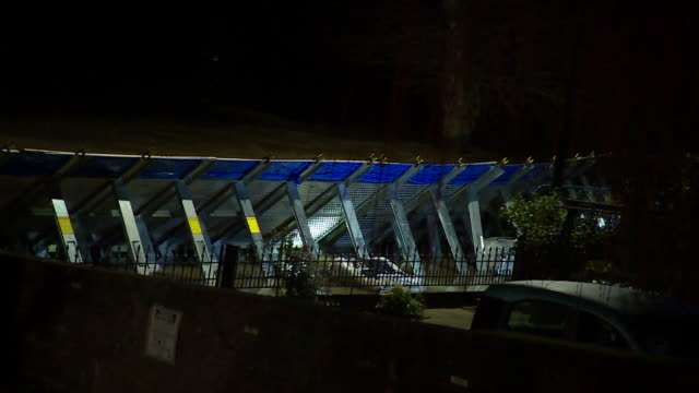 flood barrier at night in ironbridge, shropshire, with the river severn pressing up against the flood defence - ironbridge shropshire stock videos & royalty-free footage