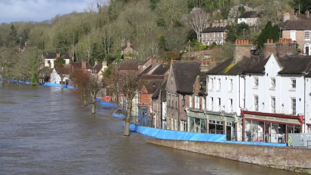 flood barriers at ironbridge in shropshire, with the river severn in flood conditions after the wettest february on record in the uk, february 2020. - ironbridge shropshire stock videos & royalty-free footage