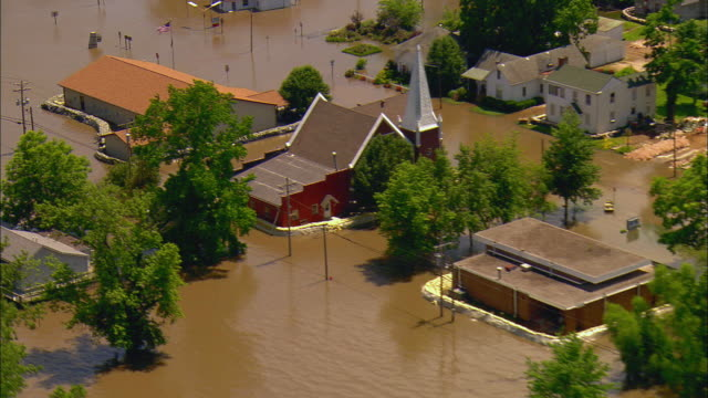 Flood control dam in middle of flooded Mississippi River/ Town including church sitting in water/ Clarksville Missouri
