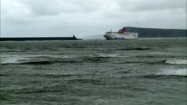 flood damage across the uk; wales: pembrokeshire: fishguard: day various shots stena line ferry near to coast [stranded passengers on board] int vox... - pembrokeshire stock-videos und b-roll-filmmaterial