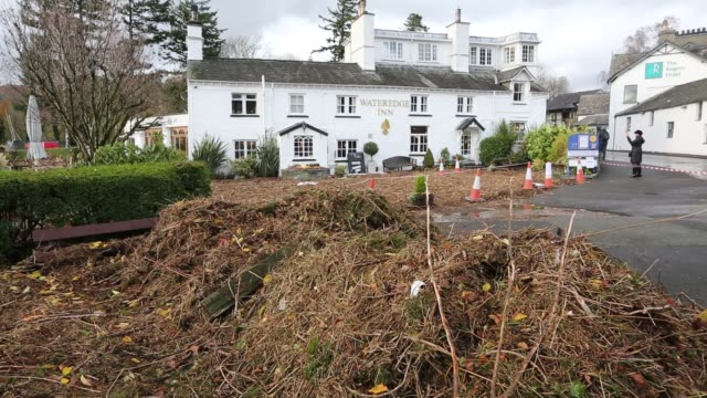 flood debris surrounding the wateredge hotel in ambleside, lake district, uk, following flooding and high lake levels in november 2015. - branch stock videos & royalty-free footage