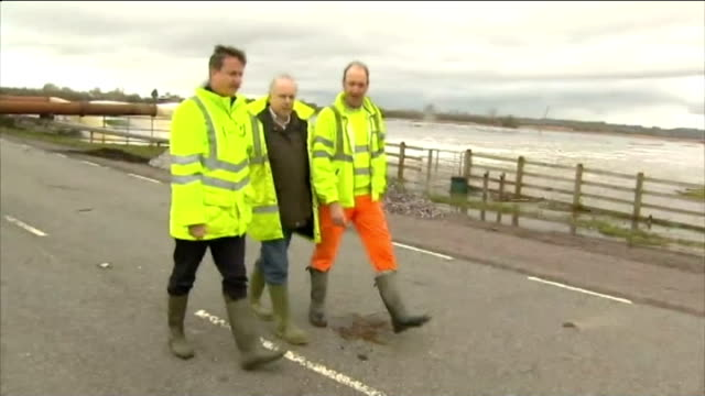vídeos de stock e filmes b-roll de pembrokeshire various shots david cameron mp wearing wellington boots and yellow jacket along road with others inspecting flooded rural area - pembrokeshire