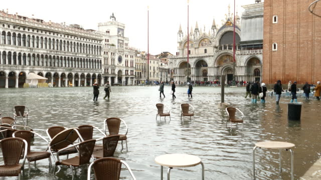 4k flood on st. marc's square in venice, italy - venice italy stock videos & royalty-free footage