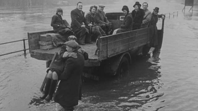 1947 montage flood rescue scenes exemplifying the social nature of man / united kingdom - nautical vessel stock videos & royalty-free footage