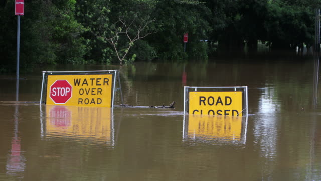 flood sign under water in the lismore cbd - flood stock videos & royalty-free footage