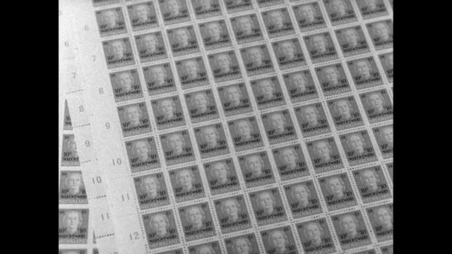 vs flood stamps rolling off printing press and sheets featuring image of queen juliana tencent surcharge on these stamps will benefit the national... - オーストリア文化点の映像素材/bロール