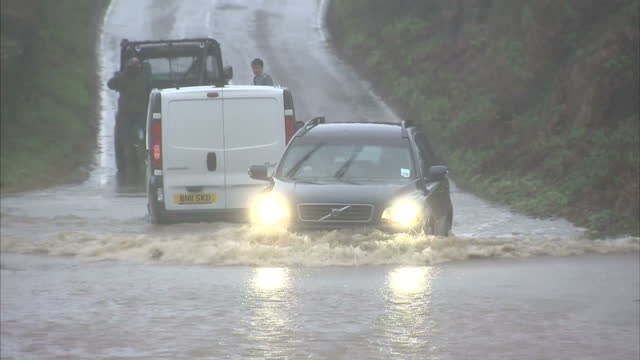 flood warnings are in place across most of britain tonight after severe storms brought strong winds and torrential rain to most parts of the country... - the morning after stock videos & royalty-free footage