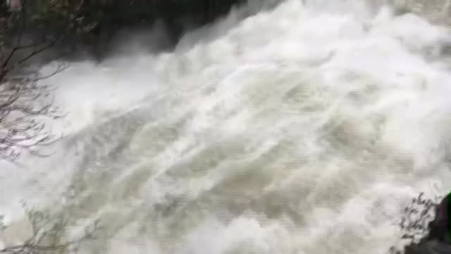 flood warnings in place across country wales ext water rushing along pan river flowing river with high waters after rainfall under bridge pan - natural disaster stock videos & royalty-free footage