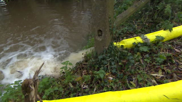 flood water being pumped away from flooded village of fishlake in doncaster - village stock videos & royalty-free footage