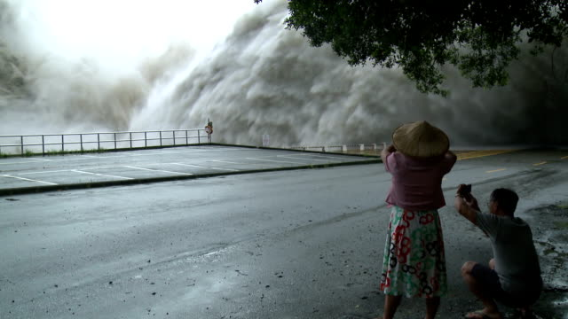 flood water bursts from hydroelectric dam  - hurrikan stock-videos und b-roll-filmmaterial