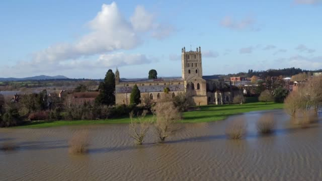 flood water continues to surround tewkesbury abbey gloucestershire in the aftermath of storm dennis those already battling with the aftermath of... - damaged stock videos & royalty-free footage