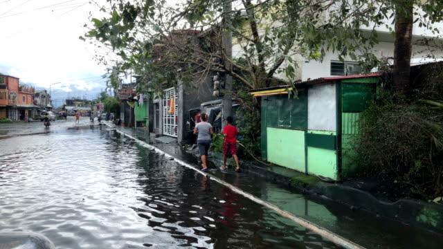 flood water cover street after typhoon kammuri dumps heavy rain - victim stock videos & royalty-free footage