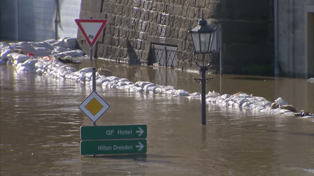 flood water covering whole roads and streets, flood defences protecting buildings submerged dresden hit by floods on june 05, 2013 in dresden,... - dresden germany stock videos & royalty-free footage