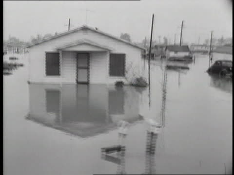 flood water covers the streets in a neighborhood. - anno 1952 video stock e b–roll