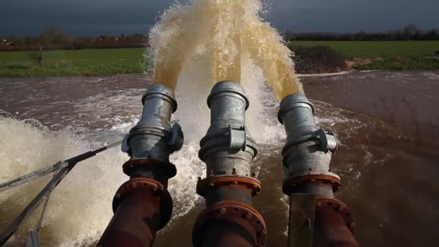 cu flood water is seen pumped into the river at the pumping station near fordgate on the somerset levels near bridgwater on february 9 2014 in... - somerset levels stock videos and b-roll footage