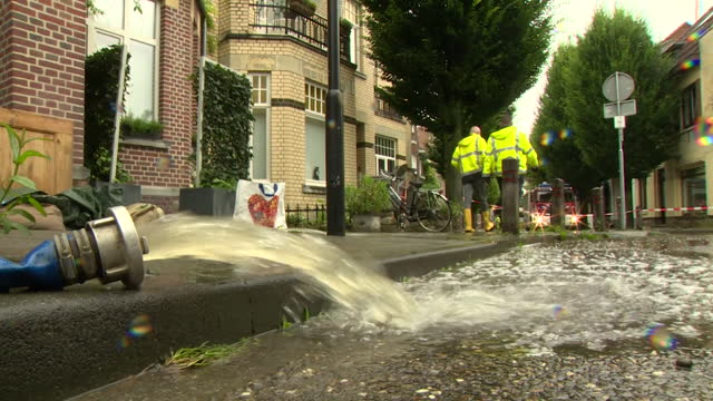 """flood water pumped away in valkenburg, in the limburg province of netherlands - """"bbc news"""" stock videos & royalty-free footage"""
