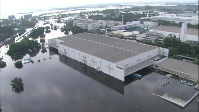 Flood water surrounds a Canon camera factory in Thailand