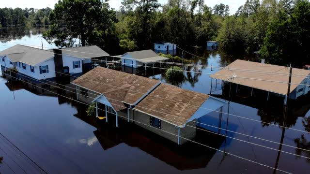 stockvideo's en b-roll-footage met flood waters are seen surrounding homes after heavy rains from hurricane florence on september 19, 2018 in lumberton, north carolina. the area was... - north carolina amerikaanse staat