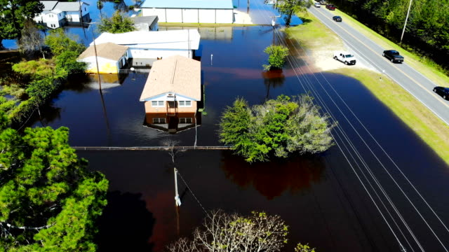 Flood waters are seen surrounding homes after heavy rains from Hurricane Florence on September 19 2018 in Lumberton North Carolina The area was...