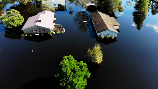 flood waters are seen surrounding homes after heavy rains from hurricane florence on september 19 2018 in lumberton north carolina the area was... - natural disaster stock videos & royalty-free footage