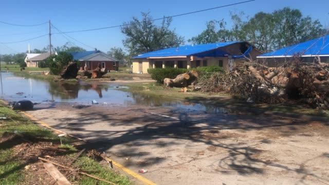 vídeos y material grabado en eventos de stock de flood waters from hurricane delta stand near homes damaged by hurricane laura on october 10, 2020 in lake charles, louisiana. hurricane delta made... - gulf coast states
