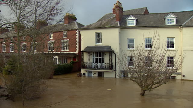 flood waters half way up a front door of a house in hereford after storm dennis - storm stock videos & royalty-free footage