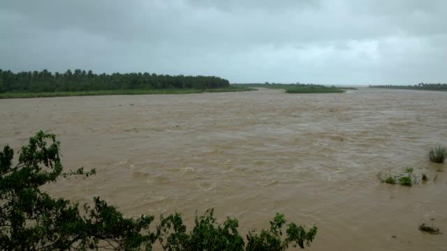 flood waters in river after typhoon sarika hits philippines - 集中豪雨点の映像素材/bロール