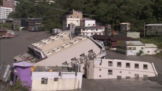 flood waters ravage a town in the aftermath of a hurricane. - flood stock videos & royalty-free footage