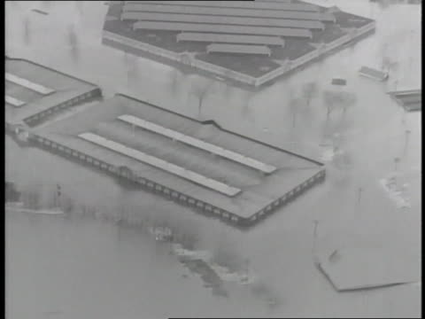 flood waters reach the rooftops of buildings in springfield massachusetts - 1936 stock videos & royalty-free footage