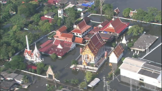 Flood waters surround a temple in Thailand in an aerial view