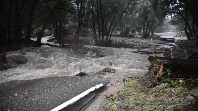 flood waters swept through jamestown, colorado, turning james creek and little jim creek into a torrent of water that divided the town in half,... - dragging stock videos & royalty-free footage