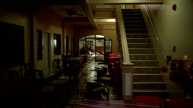 vídeos de stock, filmes e b-roll de flooded and damaged interior of a hotel after super typhoon mangkhut hit the philippines - destruição